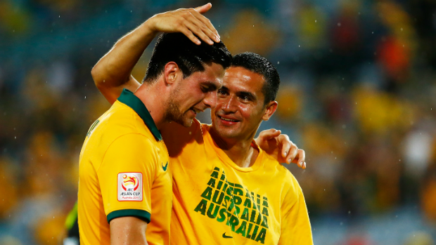 Tim Cahill congratulates Socceroos teammate Tomi Juric after win over Oman.