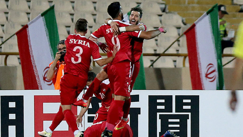 Syria booked third spot in Group A following a 2-2 draw with Iran.