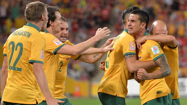 Socceroos players celebrate Tim Cahill's goal against China in the Asian Cup quarter final.