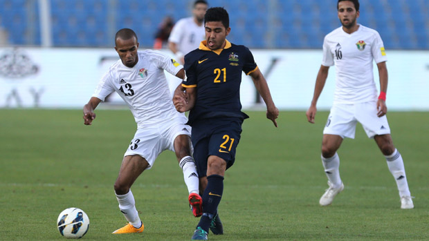 Soccceroos midfielder Massimo Luongo fights for the ball with Jordan's Yaseen Bakheet.