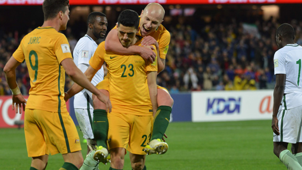 Tom Rogic celebrates with Aaron Mooy after scoring against Saudi Arabia.