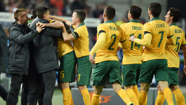 Socceroos players celebrate Mile Jedinak's second-half goal against Germany.