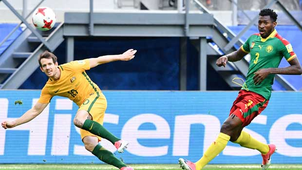 Caltex Socceroos winger Robbie Kruse gets a shot away against Cameroon.