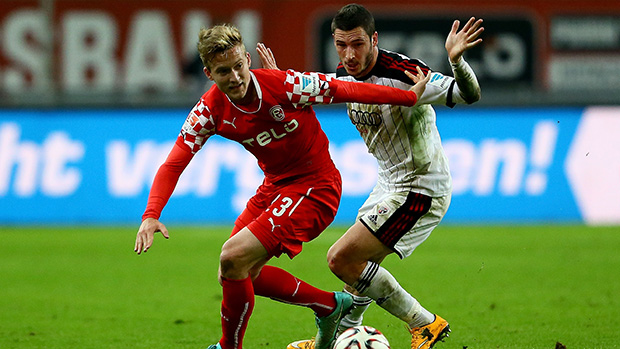 Socceroos Ben Halloran and Mathew Leckie compete for the ball in Germany's Second Bundesliga.