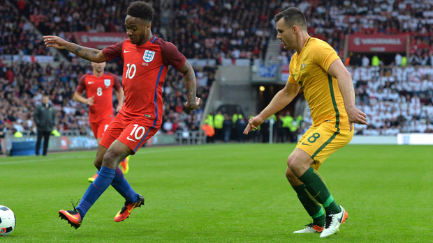 Bailey Wright fights for the ball with England winger Raheem Sterling at the Stadium of Light.