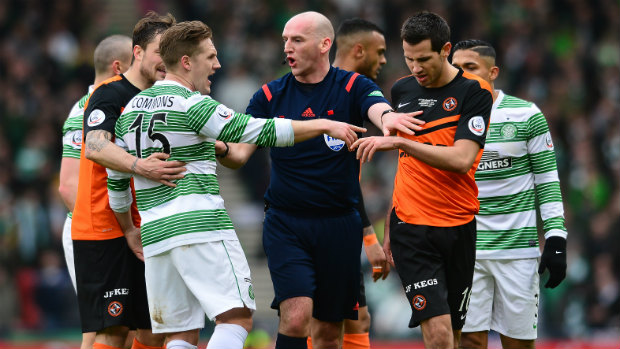 The referee separates Kris Commons and Ryan McGowan in the Scottish League Cup final.