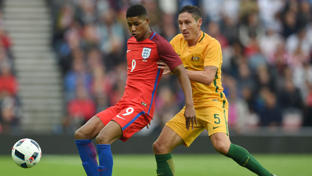 England's Marcus Rashford fights for the ball with Socceroos midfielder Mark Milligan.