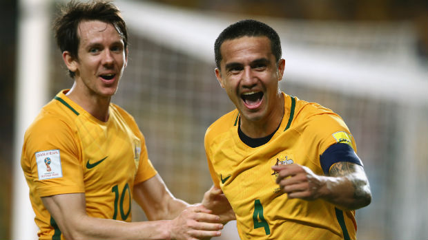 Tim Cahill celebrates opening the scoring against Jordan in Sydney with Robbie Kruse