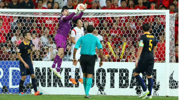 Socceroos goalkeeper Mat Ryan leaps high to make a save against Korea Republic.