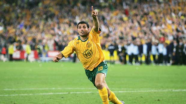 John Aloisi about to run off to celebrate after stroking home the penalty that sent the Caltex Socceroos to the 2006 FIFA World Cup.