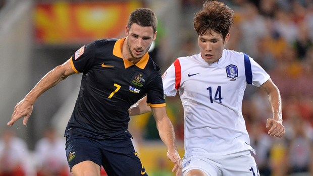 Socceroo winger Mathew Leckie fights for the ball with Korea's Han Kook-young.