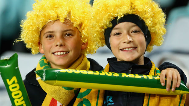 Two young fans show their support for the Caltex Socceroos.