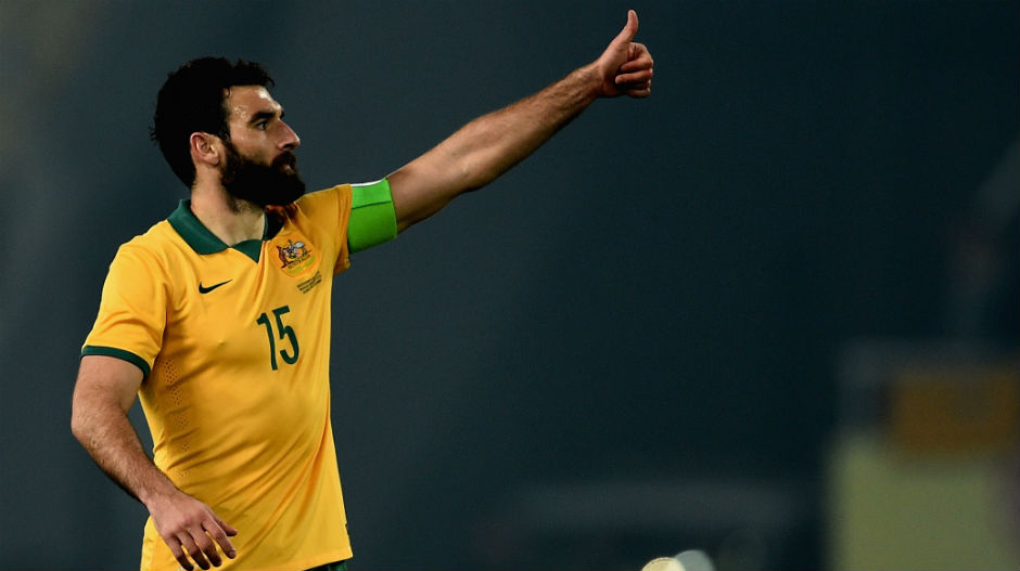 Socceroos captain Mile Jedinak gives the thumbs up to the sideline.