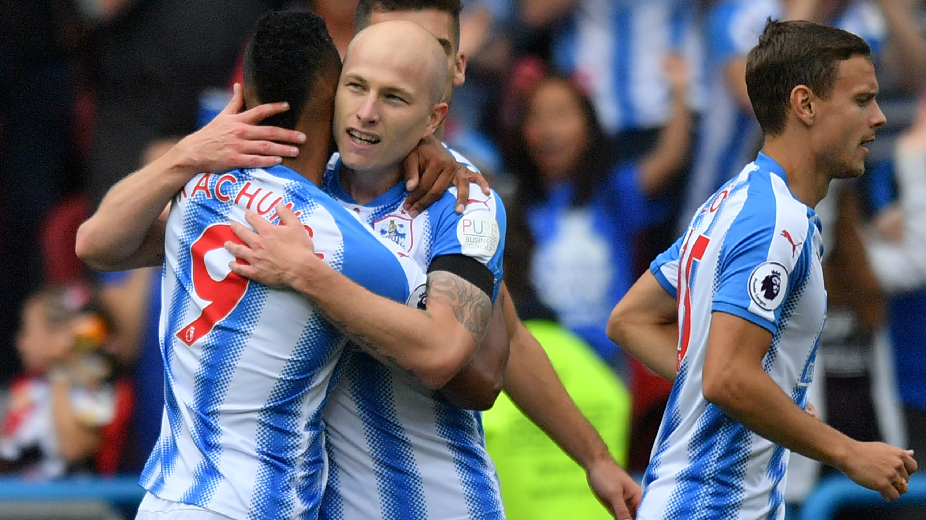 Aaron Mooy is congratulated by his Huddersfield Town teammates after scoring his fantastic winning goal against Newcastle United.