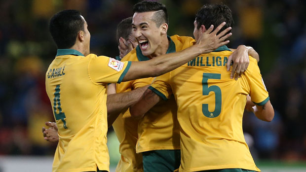 Socceroos players celebrate Jason Davidson's goal against the UAE.