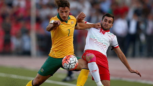 Mat Leckie shows his strength on the ball against Tajikistan.