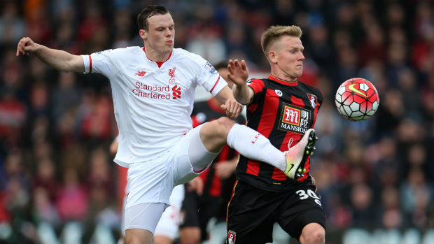 Liverpool defender Brad Smith tries to win the ball from Bournemouth's Matt Ritchie.
