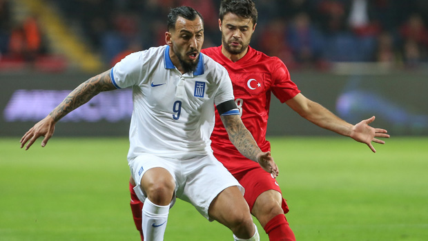 Benfica and Greek star Kostas Mitroglou on the ball in a friendly against Turkey.