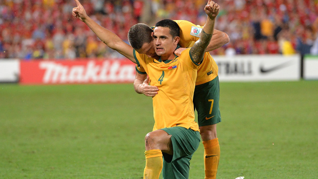 Cahill celebrates after scoring against China PR.