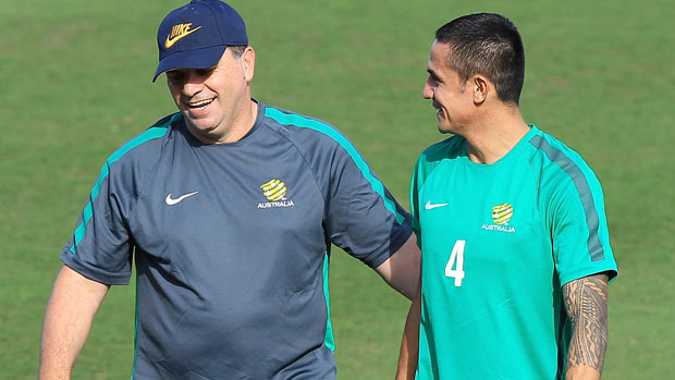 Ange Postecoglou and Tim Cahill during a Caltex Socceroos training session.