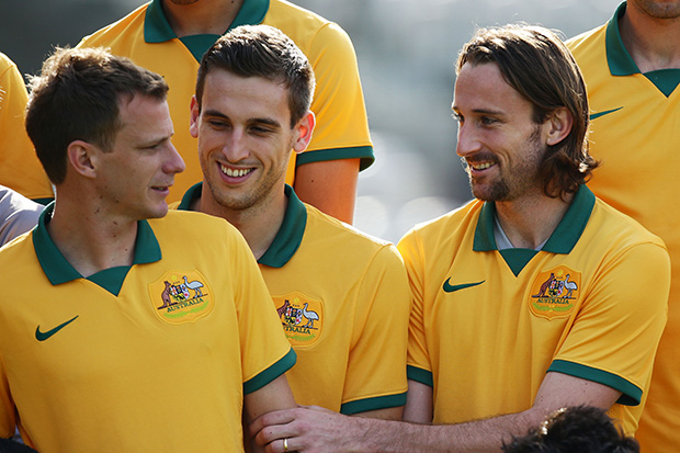 Josh Kennedy bonds with teammates during the Socceroos official team photograph session.