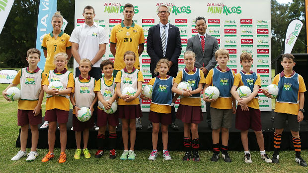 Ambassadors Steph Catley, Brett Emerton, Tomi Juric, FFA CEO David Gallop and AIA Australia CEO Damien Mu with kids at the MiniRoos launch.