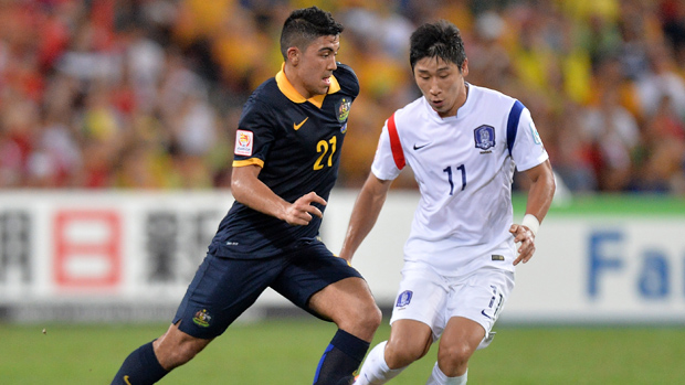 Massimo Luongo takes on the South Korean defence in Brisbane.