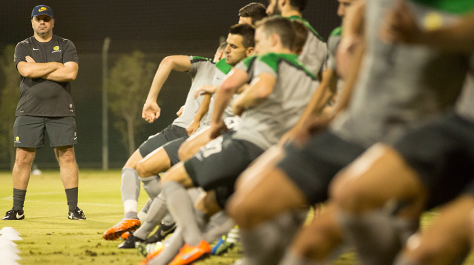 Caltex Socceroos coach Ange Postecoglou puts his squad through a training session.