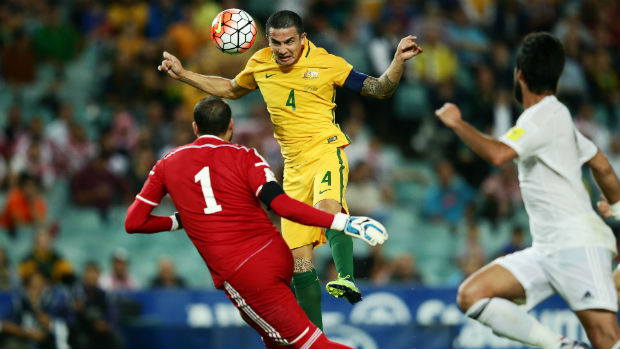 Striker Tim Cahill heads home the Socceroos' third goal against Jordan before half-time.