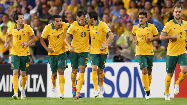Socceroos players celebrate an early goal against UAE.