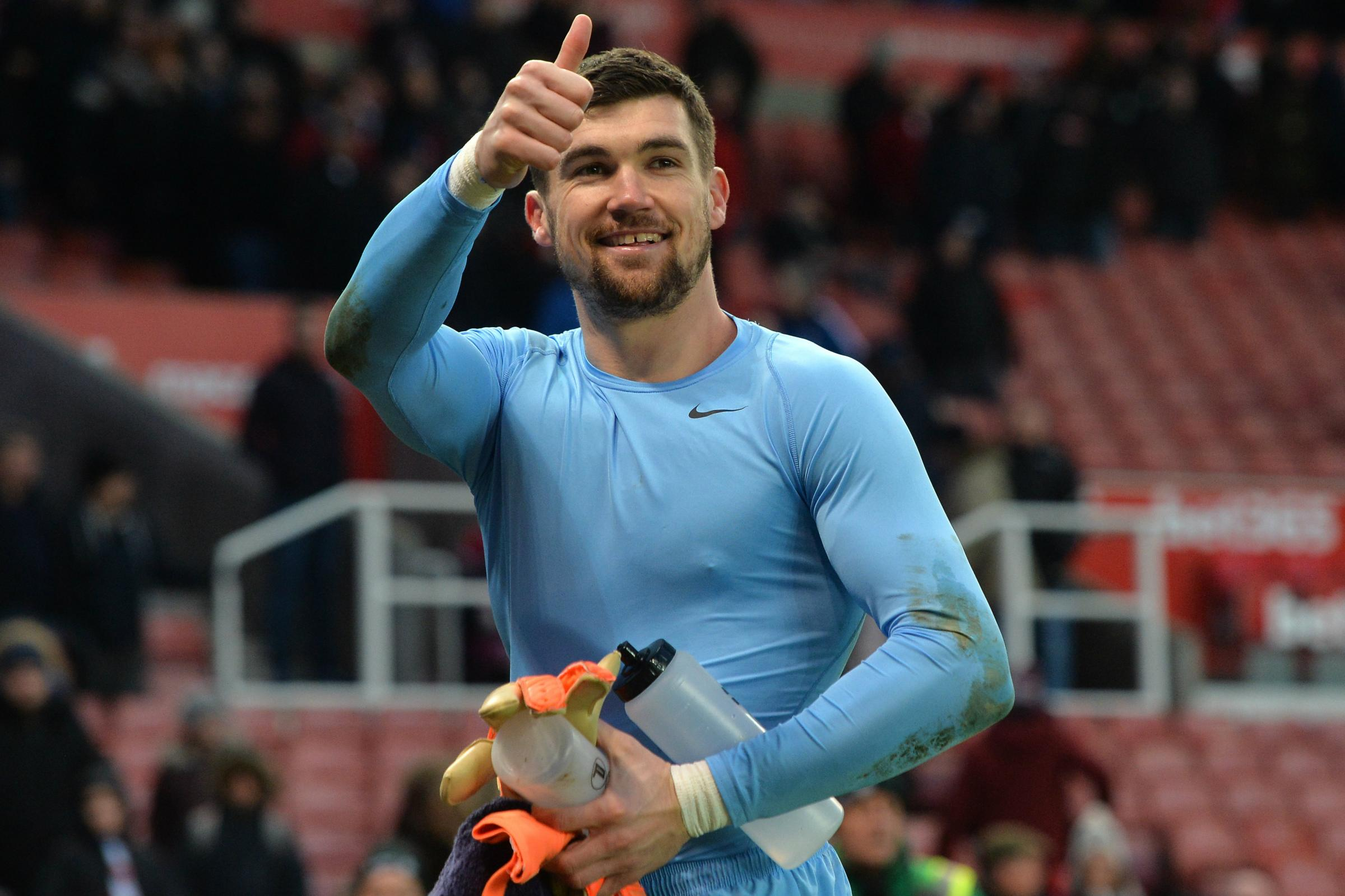 Mat Ryan acknowledges the fans at the bet365 Stadium.