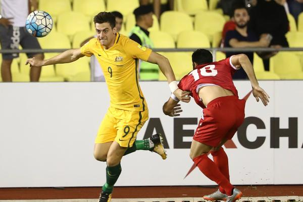 Tomi Juric breaks free of his Syrian defender in the first leg.