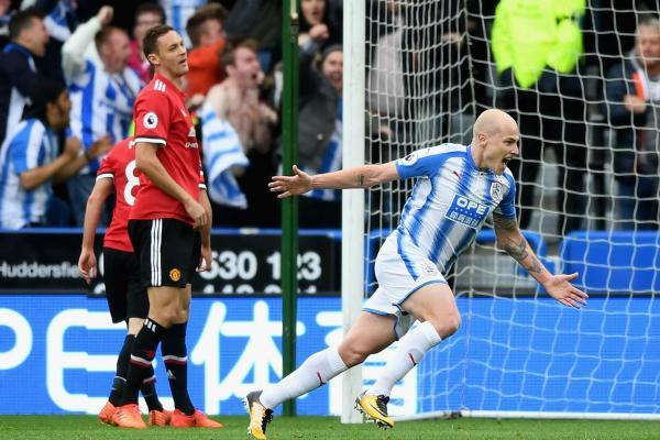 Aaron Mooy celebrates scoring against Manchester United.