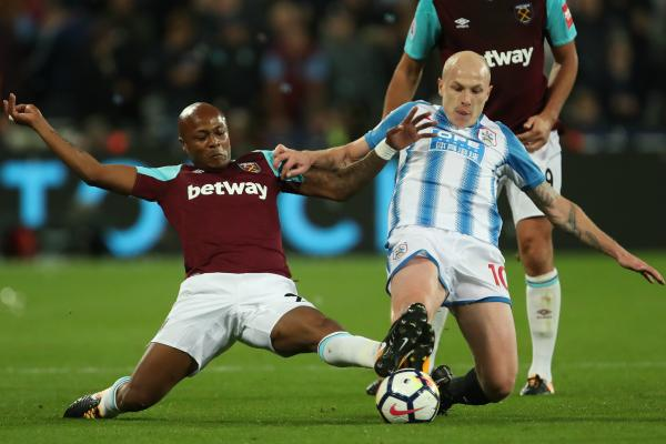 Aaron Mooy gets a tackle in against West Ham.