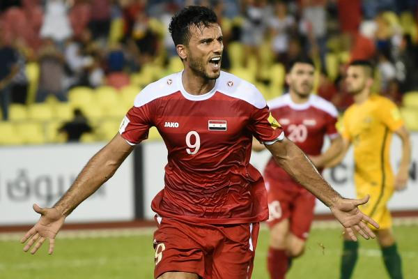 Omar Al Soma celebrates his goal against the Caltex Socceroos on Thursday night.