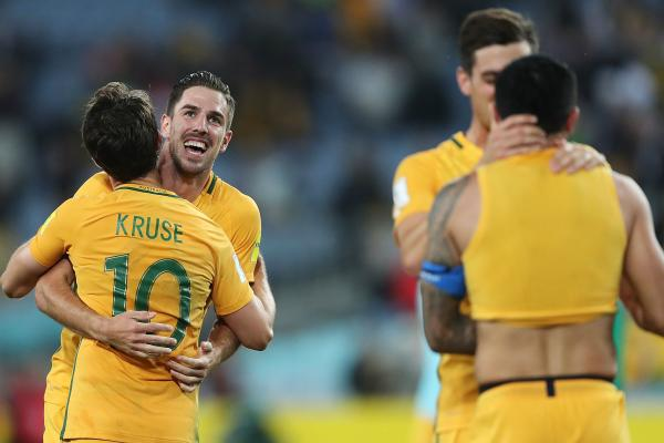 The Caltex Socceroos celebrate after the win over Syria in Sydney.
