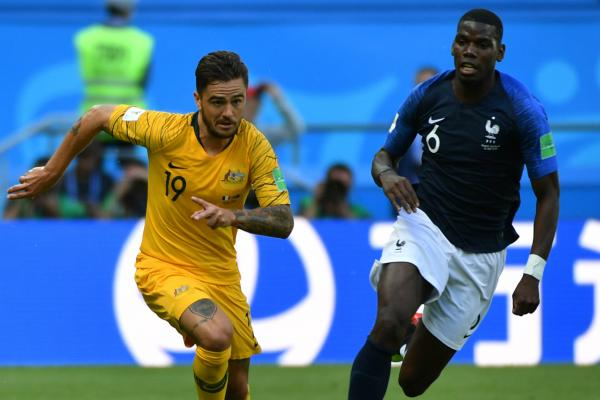 Josh Risdon races clear from France's Paul Pogba.