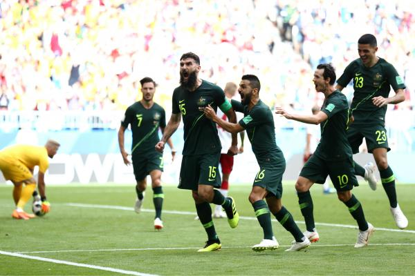 Mile Jedinak scores against Denmark.