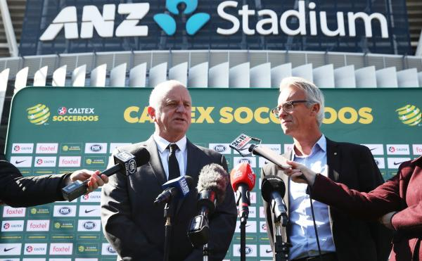 Graham Arnold addresses the assembled media at ANZ Stadium