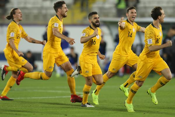 Socceroos celebrate shootout win
