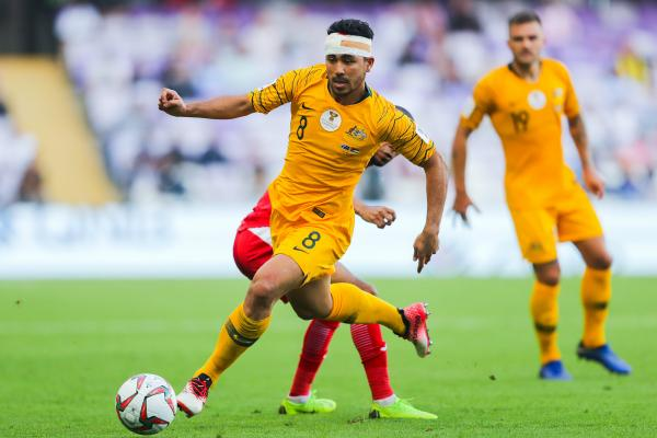 A bandaged Massimo Luongo drives forward from midfield.