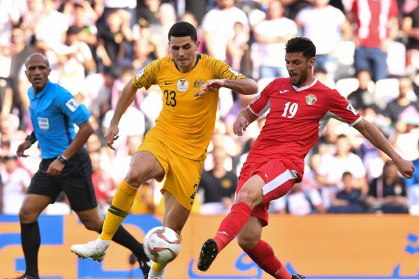 Tom Rogic on the ball against Jordan.