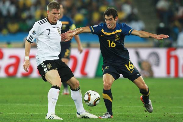 Carl Valeri battles with Bastian Schweinsteiger at the 2010 World Cup
