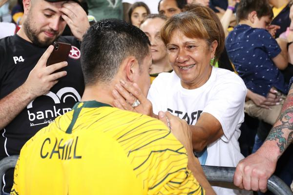 Tim Cahill with his mum Sisifo after his last match for the Caltex Socceroos