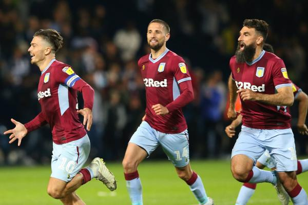 Mile Jedinak celebrates Aston Villa's shootout win