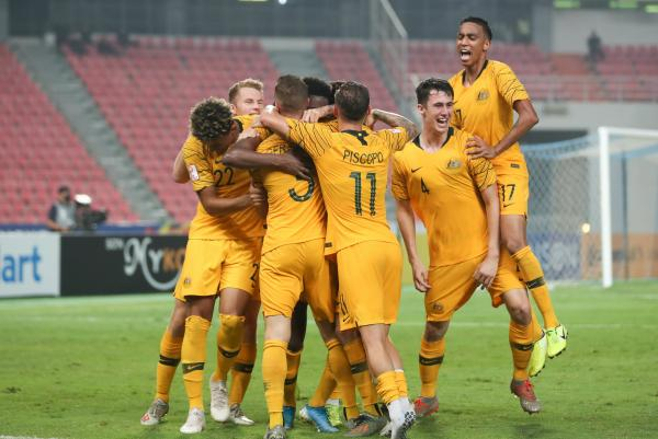 Australian players celebrate Toure's winning goal