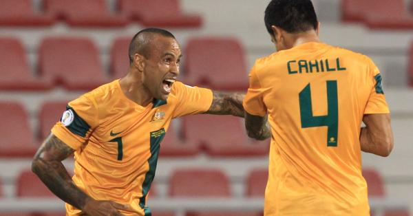 Archie Thompson celebrates Socceroos Cahill