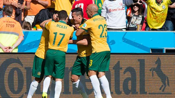 The Socceroos celebrate after Tim Cahill netted a spectacular equaliser against the Netherlands.