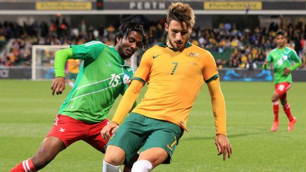 Socceroo Mathew Leckie shields possession against Bangladesh in Perth.