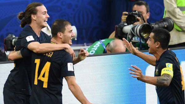The Caltex Socceroos celebrate taking a first-half lead in their FIFA Confederations Cup clash against Chile.
